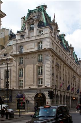 Side view of the Ritz hotel, Piccadilly, including a neon sign above an entrance