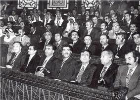 Large group of men sitting in rows