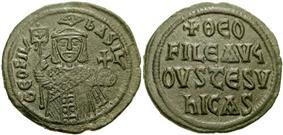 Image of bronze coin, a standing crowned man holding a labarum and a globus cruciger on the obverse, with a Greek-Latin inscription on the reverse