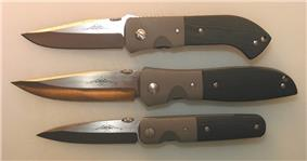 3 folding fighting knives with micarta handles and titanium bolsters