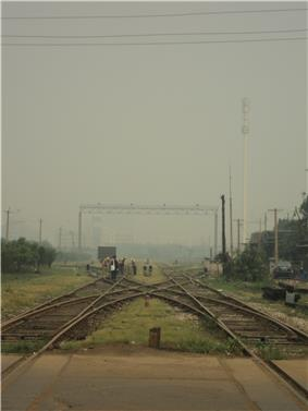a x-shaped interception of railroads with a repair crew carrying out maintenance