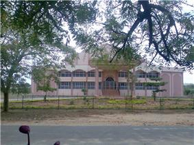 a building viewed amidst trees