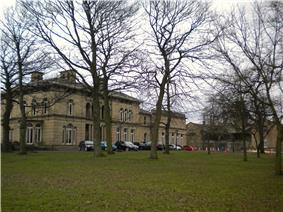 Victorian Mansion seen through winter trees