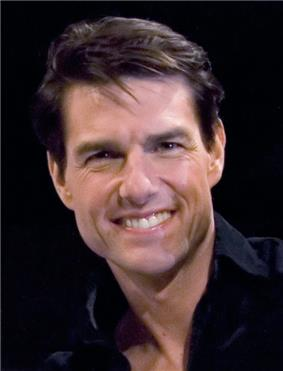 Head and upper body of a man with short brown hair, wearing a black shirt, smiling.