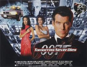 A man wearing evening dress holds a gun. On his sides are a white woman in a white dress and an Asian woman in a red, sparkling dress holding a gun. On the background are monitors with scenes of the film, with two at the top showing a man wearing glasses holding a baton. On the bottom of the screen are two images of the 007 logo under the title