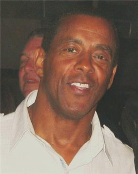 A picture of Tony Dorsett on a phone.
