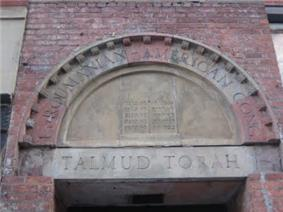 Stones over a doorway arch with the incomplete name