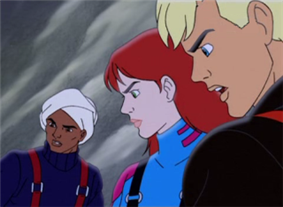 Characters Hadji Singh, Jessie Bannon, and Jonny Quest are shown with faces emphasized in an ice setting. Hadji is very tan-skinned, wearing a turban, navy blue sweater, and red suspenders. Jessie is pale-skinned with red hair and green eyes, and is wearing a blue snow-suit with pink highlights and black suspenders. Jonny has blonde hair and blue eyes, and is lightly tanned; he's wearing a black snow-suit with red suspenders.