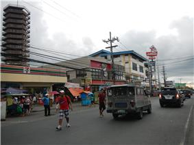 A 7-Eleven and Jollibee in Trece Martires City