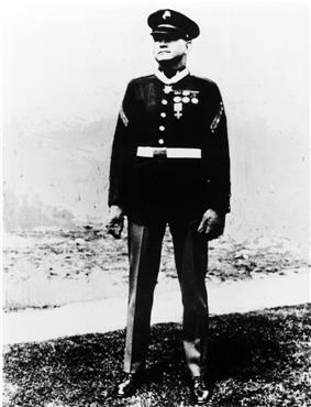 Full length portrait of standing man in circa 1930 U.S. Marine dress uniform.