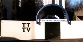 The entrance to the studio covered by a blue semi-circle.