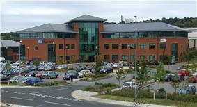 A building complex with a car park