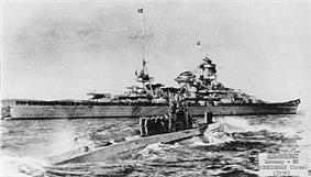 U-47 returns to port after sinking HMS Royal Oak. The battleship Scharnhorst is in the background