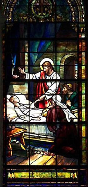 Christ stands at bedside of a sick young girl, holding her hand and gesturing for her to rise, while her parents kneel in prayer.
