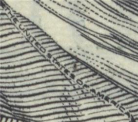 Close-up of microprint incorporated on US $100 paper currency