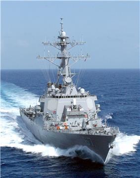 A grey ship on the ocean