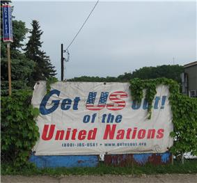 Political sign in white background advocating for removal of United States from the United Nations