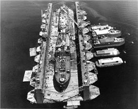USS Artisan (ABSD-1) with Antelope (IX-109) and LST-120 in the dock at Espiritu Santo, New Hebrides Islands, 8 January 1945