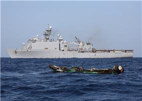 USS Ashland (LSD-48) and burned pirate skiff, 10 April 2010.