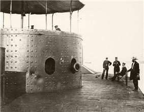 Photo showing Officers standing on deck, one seated
