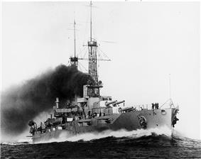 A large warship seen from the front