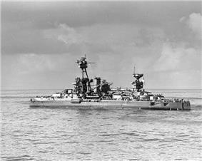 A large warship painted in camouflage pattern