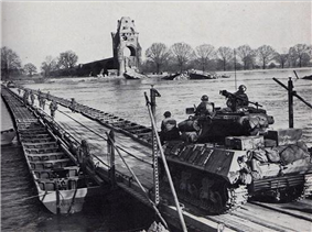 U.S. Army troops cross the Rhine on a heavy pontoon bridge, March, 1945Beck, Alfred M., et al, [http://www.history.army.mil/html/books/010/10-22/CMH_Pub_10-22.pdf ''The Corps of Engineers: The War Against Germany''], Center of Military History (U S Army), 1985. The bridge was built by the 85th Engineer Heavy Combat Battalion on March 26, 1945, 200-feet downstream from the demolished Ernst Ludwig highway bridge. It was named the Alexander Patch Bridge after the Seventh Army commander, General . A stone tower of the former bridge is visible on the opposite bank.