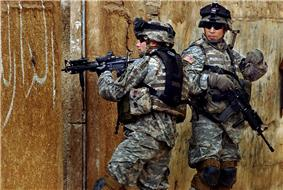 Two US Army soldiers during a patrol through Sadr City in February 2006