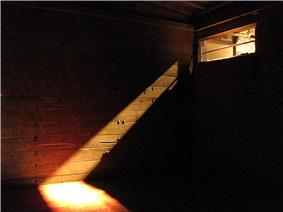 Original artifact. Brown boxcar with light creating shadows from upper right corner.