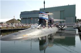 Pre-commissioning Unit New Hampshire (SSN-778) sits moored to the pier at General Dynamics Electric Boat shipyard moments before her christening ceremony commenced.