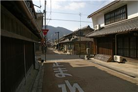 Wooden houses lining small streets.