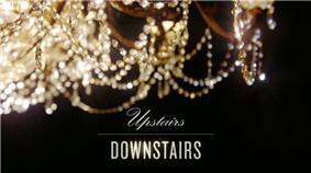 Alt=Series titles with an opulent chandelier