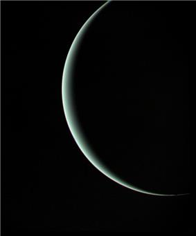 Departing image of crescent Uranus