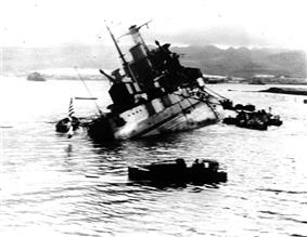 Photograph of the USS Utah capsizing during the attack on Pearl Harbor.