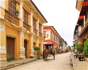 Street of three-storied ramshackle colonial style buildings.