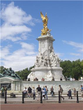 Bronze statue of winged victory mounted on a marble four-sided base with a marble figure on each side