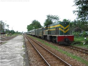 A train stopped at a station on the North–South Railway, Vietnam