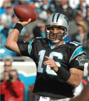 A picture of Vinny Testaverde while throwing a football.