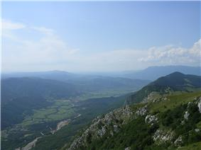 A photo showing a valley and a mountain