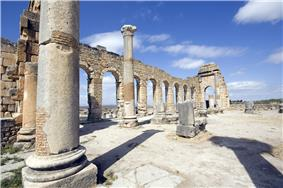 Interior view of a ruined colonnaded building showing the interior columns