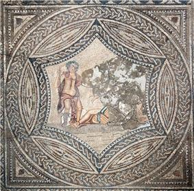 Top-down view of an elaborate geometric mosaic with a circular inset showing Bacchus encountering the sleeping Ariadne