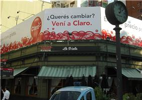 Wraparound billboard over corner business