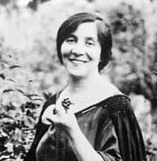 head and shoulders portrait of smiling middle-aged woman