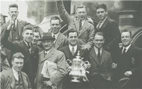 The Albion team display the FA Cup at Paddington Station after their victory in the final.