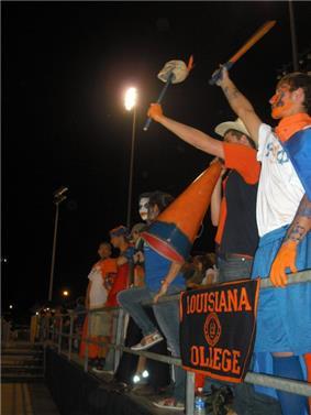 Students cheering at football game