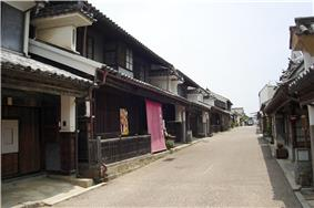 Wooden houses with white walls, roof tiles and protruding walls.