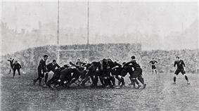 A mass of players compete for the ball in a scrum.
