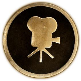 Circular 4-inch brass plaque showing a side view of a classic movie camera