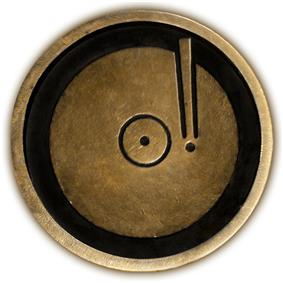 Circular 4-inch brass plaque with a top view of phonograph disc and pickup arm