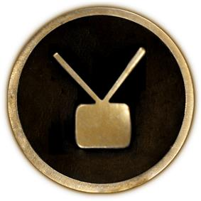 Circular 4-inch brass plaque with a tube-type television with twin aerials